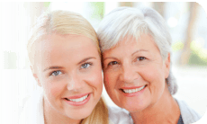 caregiver and her elderly smiling